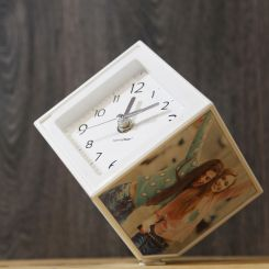 Portafotos y reloj giratorio Photo Clock